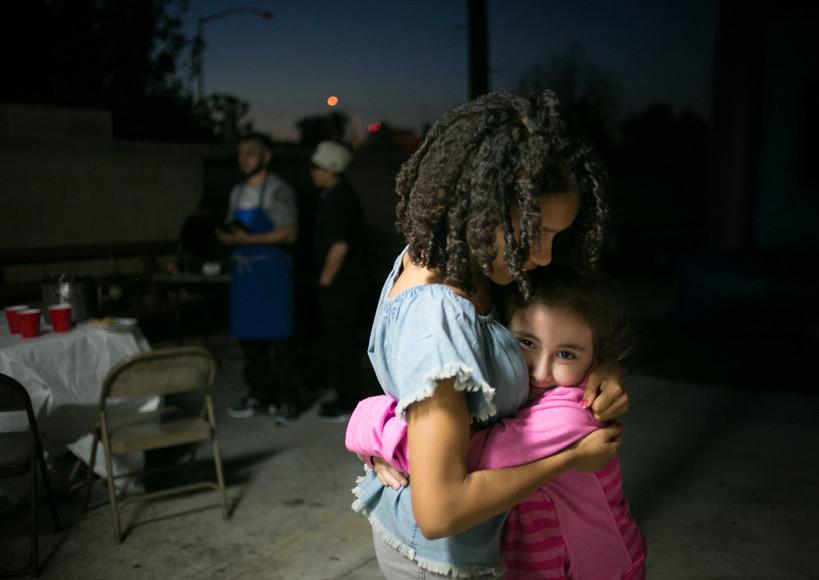 Olivia embraces her cousin Darla.