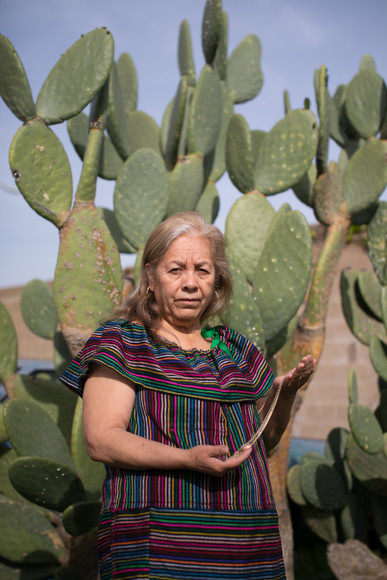 Doña Ofelia holds a precious gift from her husband, a gold necklace he gifted to her during a trip they took to Tijuana. Cruz Barrios passed away five years ago.