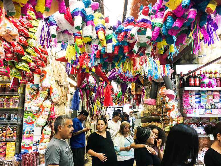 El Mercadito, a three-floor indoor shopping center that sells traditional Mexican food, indigenous herbal treatments, household items, clothing and more. They also have live Mariachi bands in the basement. Olivia's mother has fond memories of visiting El Mercadito with her father, who brought the family there to eat and listen to Mariachi bands, often until as late as 2 am.