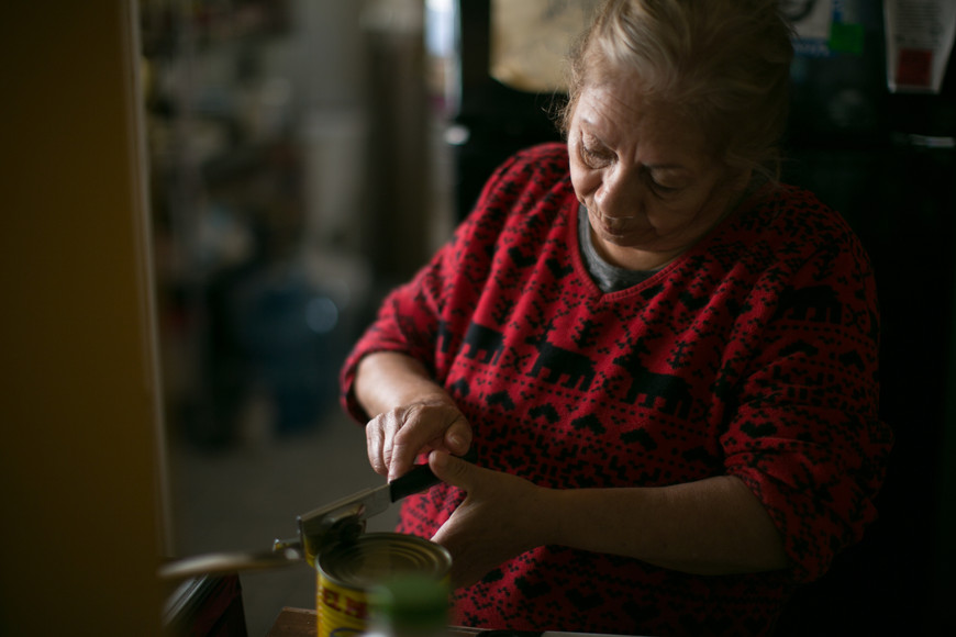 Doña Ofelia, Olivia's grandmother, welcomes us with her homemade chilaquiles and frijoles, the family's favorite.