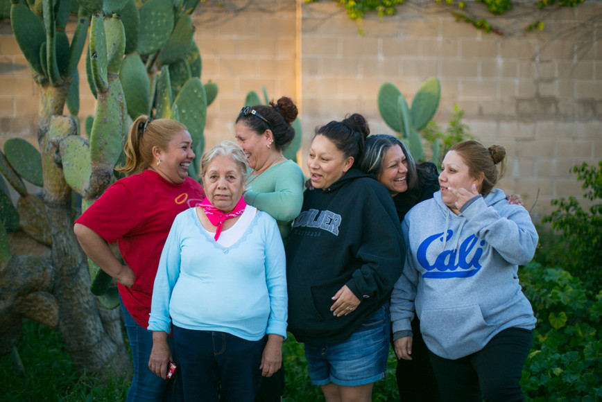 Doña Ofelia and five of her daughters share a laugh in the family's backyard. Missing from this photograph are her daughter Rosa  and her son Vicente who lives in Tijuana.