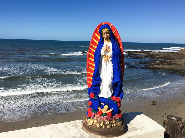 La Virgen de Guadalupe sits in front of the ocean in Valentín's hometown of Rosarito, Tijuana.