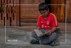 Child reading thanks to Educate for