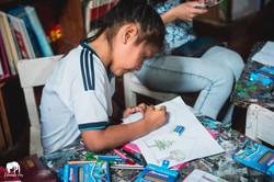 Kid using Just Smile pencils