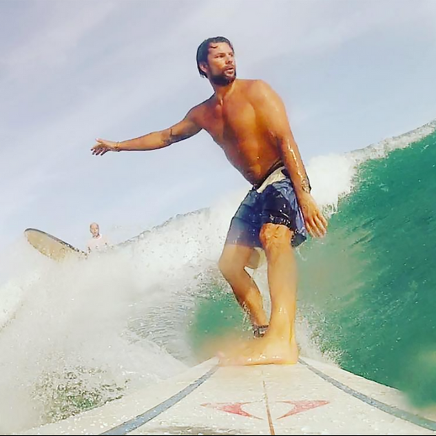 Surfing at the beach, waves