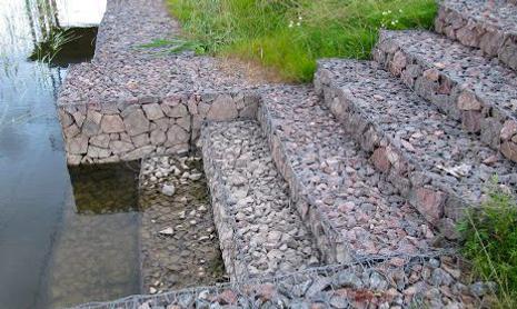 PVC Coated Hexagonal Gabions With Rocks.png