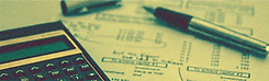 Close up of a calculator, pen and financial statement