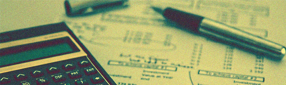 Close up of calculator and pen on a financial statement