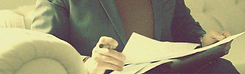 Image of man sitting reading important documents