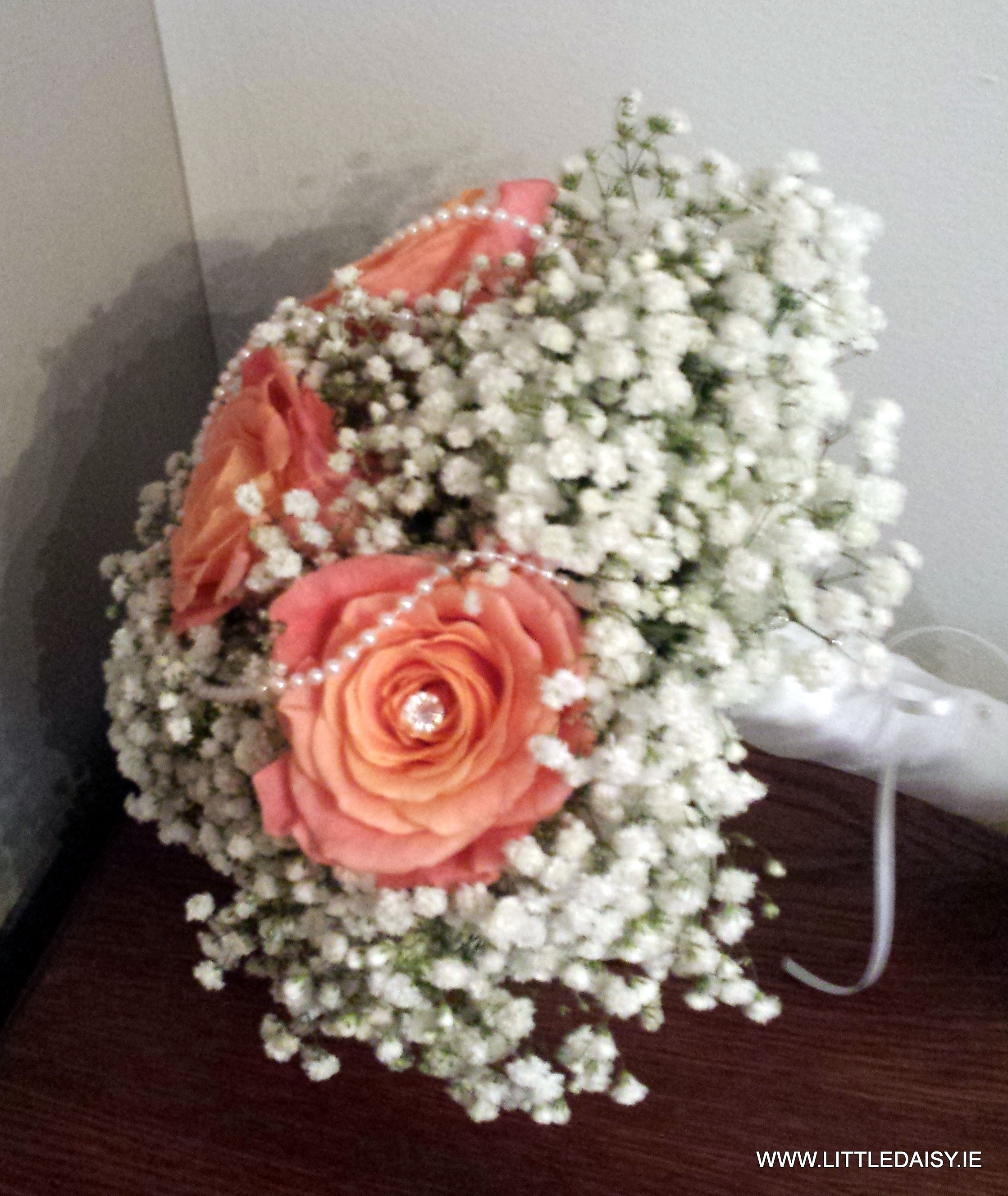Coral and orange rose