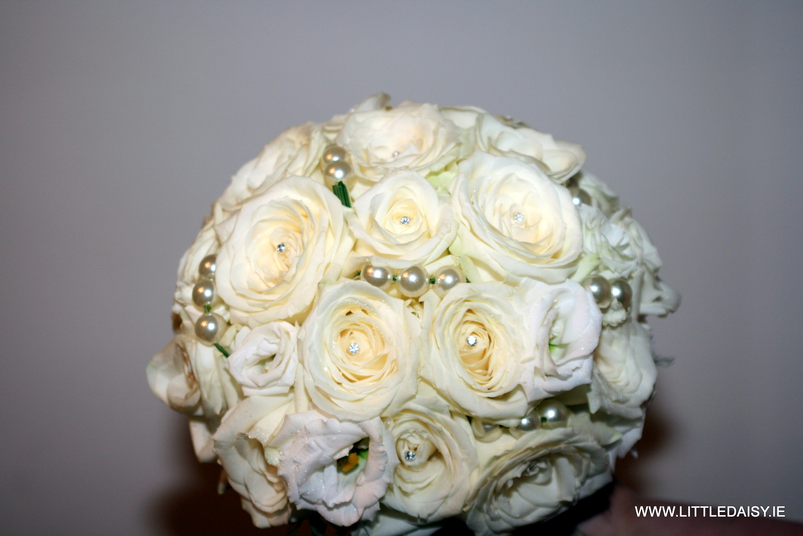 White roses and pearl beads
