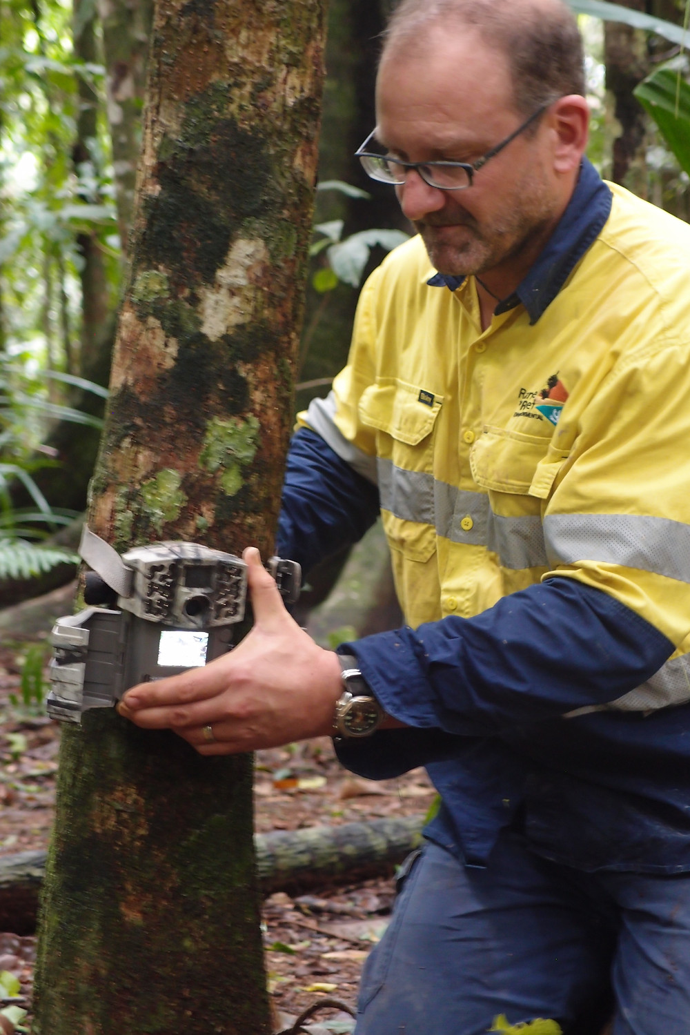 Rupert sets up a remote camera trap.