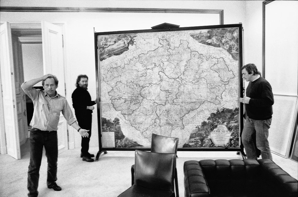 Vaclav Havel re-arranging the furniture in the Presidential Palace. January, 1990.