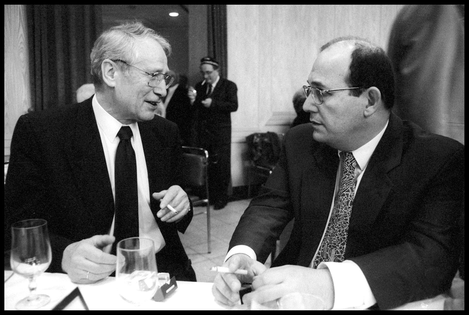 Markus Wolf, left, former head of GDR's external spying agency, at a conference in Berlin. December, 1990.