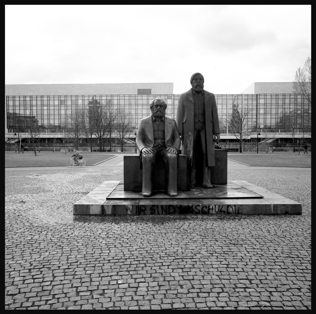 Marx and Engels in front of the GDR Parliament, East Berlin. November, 1989.