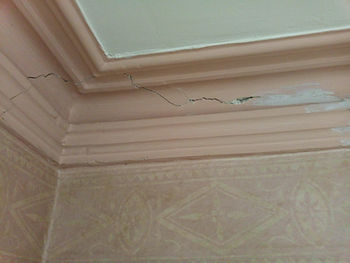Old damaged cornice at belper house before painting