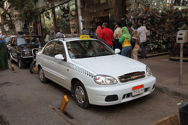Transportation in Cairo Egypt. White taxi and white cabs in Cairo