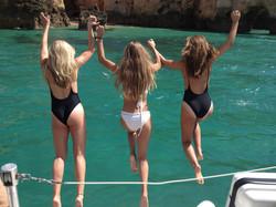 girls jumping in