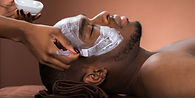 therapist-applying-face-mask-to-man.jpg