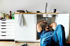 plumber-man-fixing-kitchen-sink.jpeg