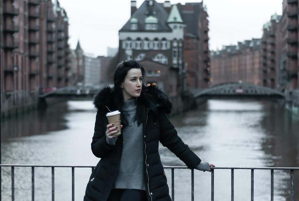 Girl standing in on the bridge in Speicherstadt in Hamburg