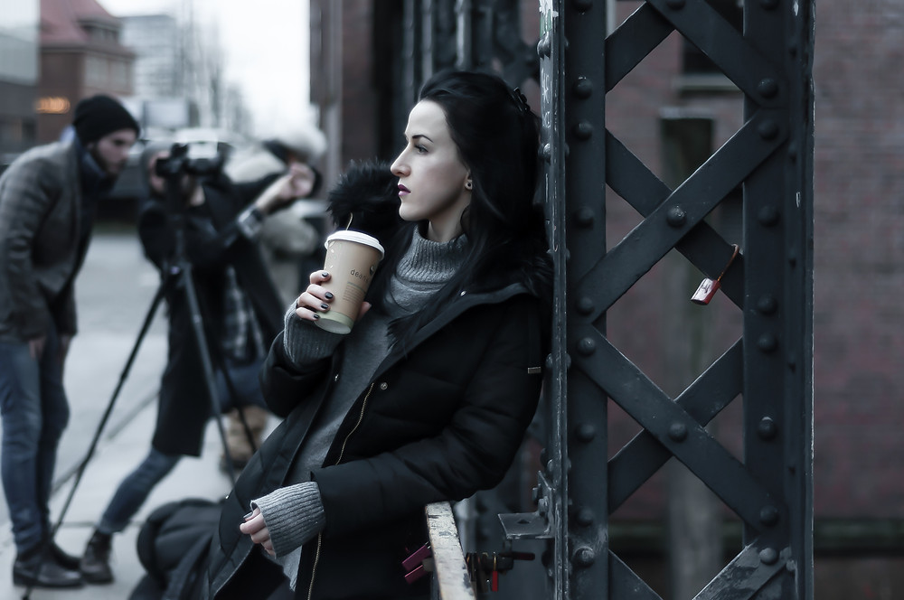 Girl with cup of take away coffee in Hamburg