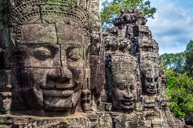 Buddhist faces on towers at Bayon Temple, Cambodia..jpg