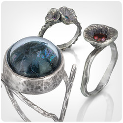 Butterfly ring and two flower rings
