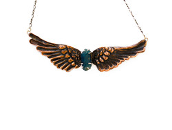 Chasing Repoussé wings with apatite