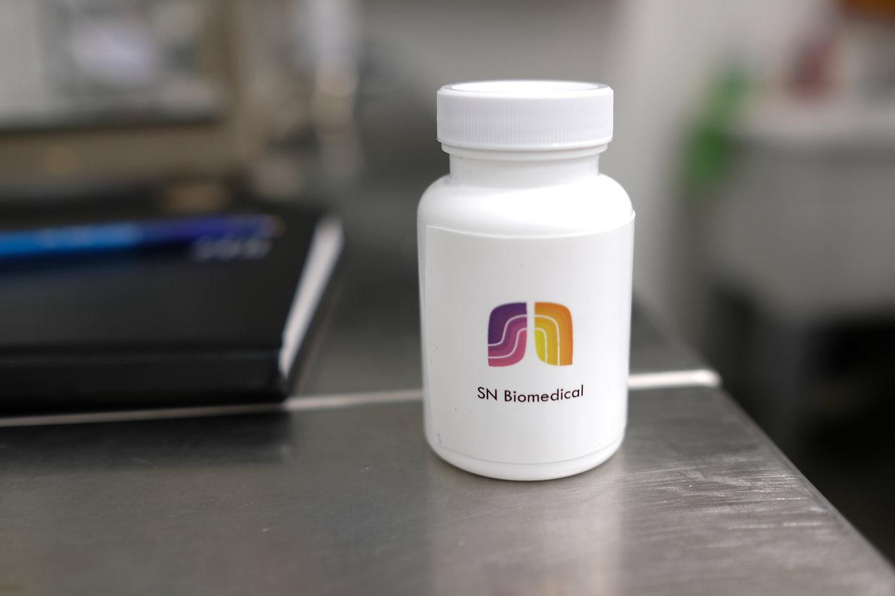bottle, tests, SN Biomedical logo