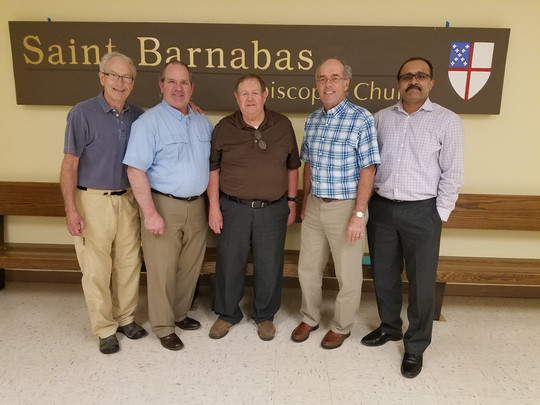 Hanging the original St. Barnabas sign in the undercroft