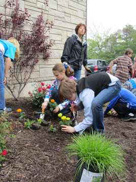 Planting St. Barnabas flower beds