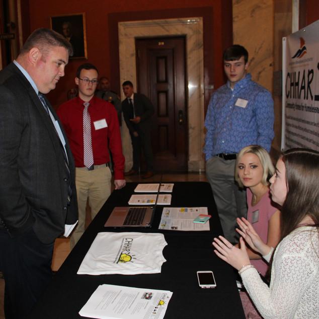Congresional Representative Brenna Early talking to Representative Chris Fugate