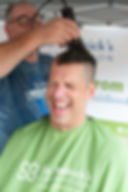 Barber Jeff Richard volunteering by shaving for the event. To raise money and awareness for childrens' cancers. Photographed event, held on Mt. Pleasant, Aug. 18, 2019