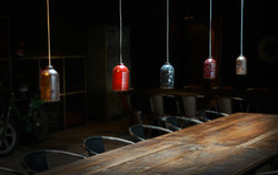 Lamps over a beautiful wooden table.