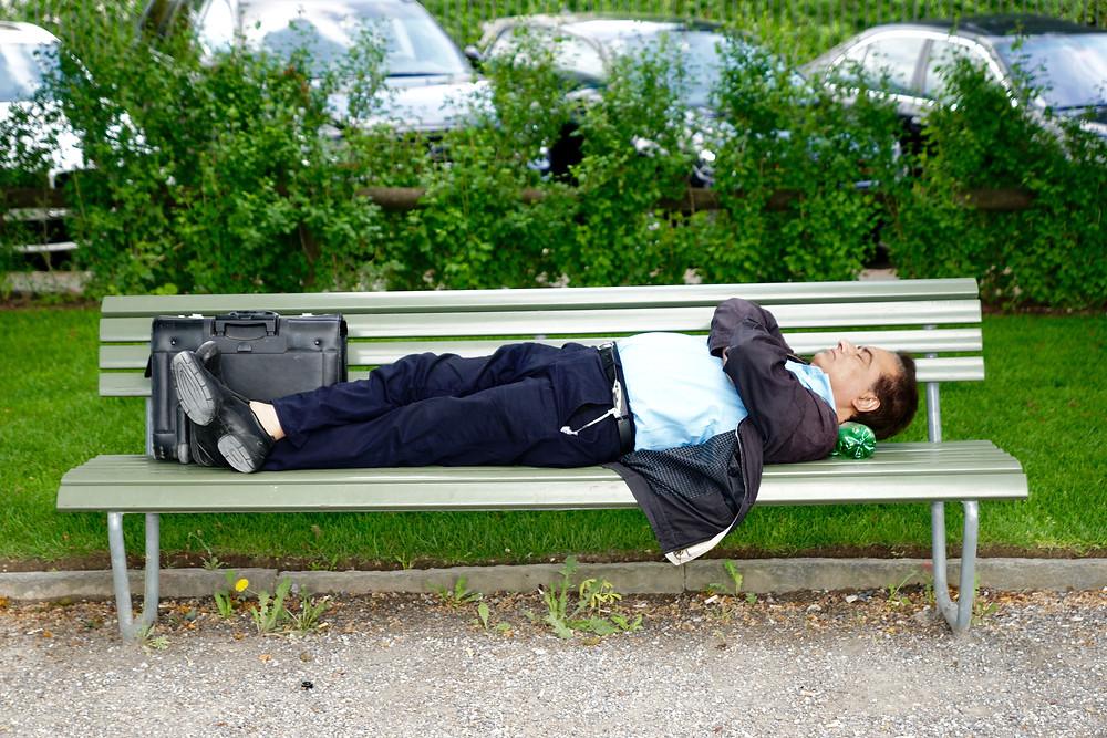 man asleep on bench