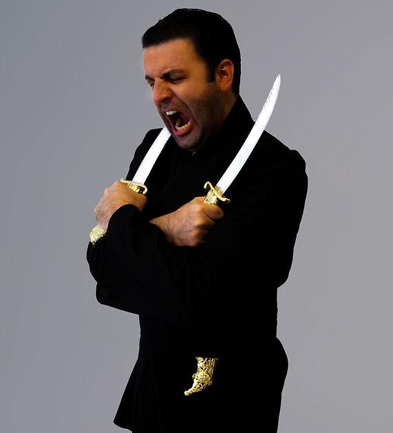 David Serero as Othello knives.jpg