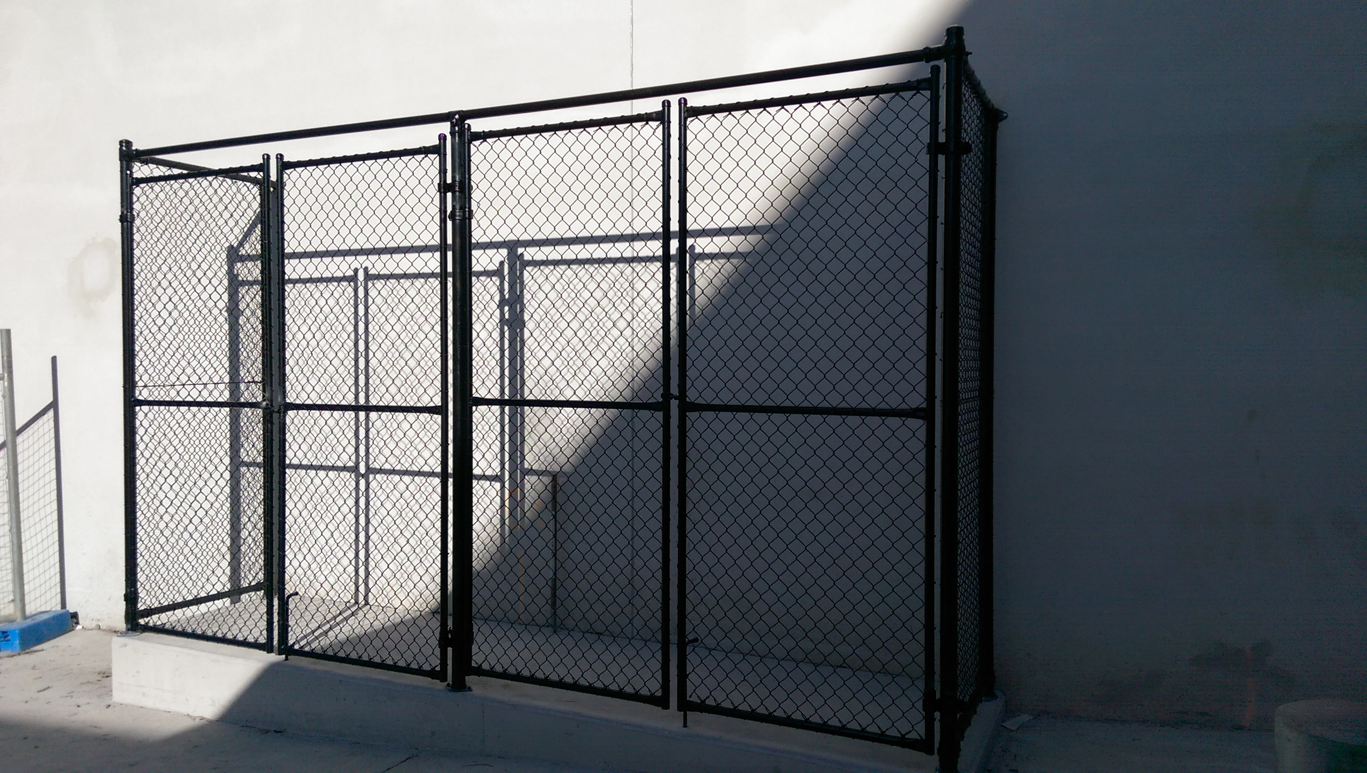 Security cage with double gate