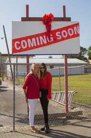 Ali & Candace Tamposi w coming soon sign