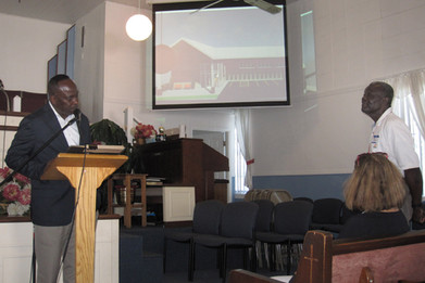 Mayor beginning presentation to Pastor.j