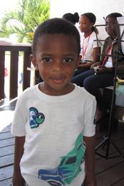 Young boy on porch.jpg