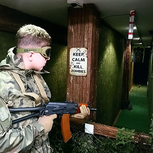 A cadet is testing an Airsoft AK74u on Awesome Airsoft's in-store firing range.