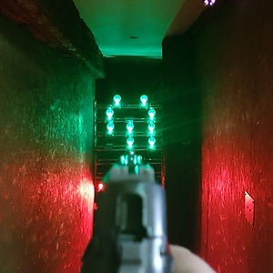 An image showcasing our light up pop up range. State of the art targetting system. We host contests as well as letting people test out their own airsoft replicas!