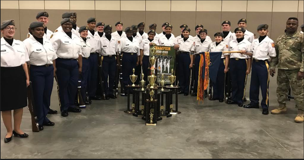 Airport's Golden Talon drill team, with trophies from the competition.