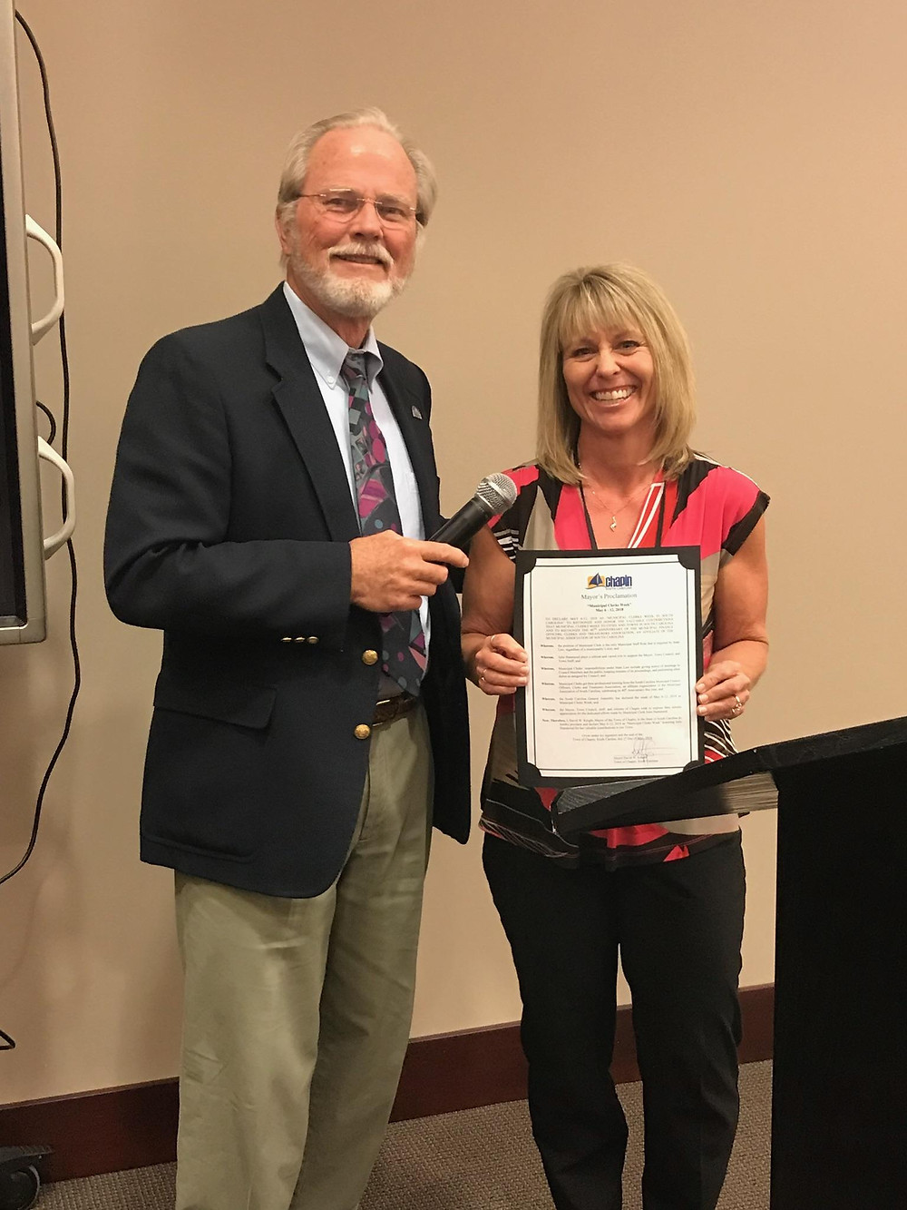 Chapin's Mayor David Knight presents a certificate of recognition to Town Clerk Julie Hammond