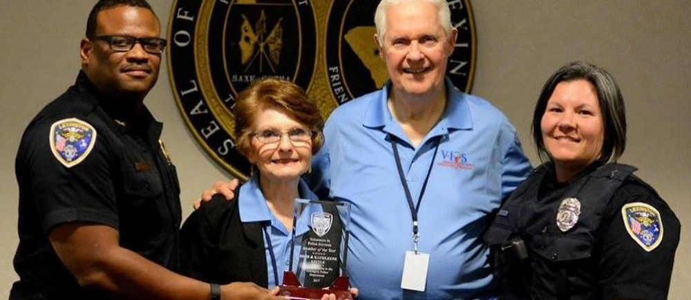 """Chief Terrence Green presented Rich and Kathleen Little with the """"V.I.P.S. of the Year"""" award"""
