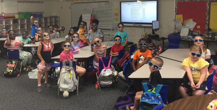First-graders wear the sunglasses they received as a grand prize winner in the Epic! Reading Challenge.