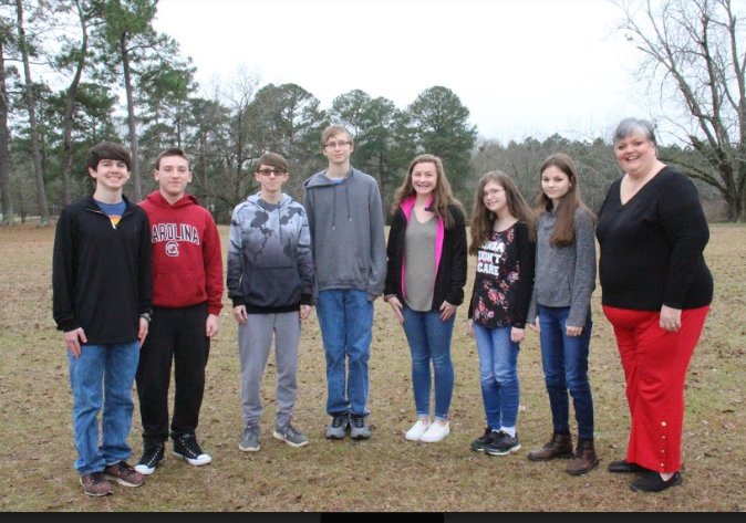 Pictured from left to right are Landon Truitt, Nathan Parker, Ethan Davis, William Taylor, Rachel Connelly, Merewyn Durst, Amber Motley and Sonya Bryant (Principal of B-L High School).