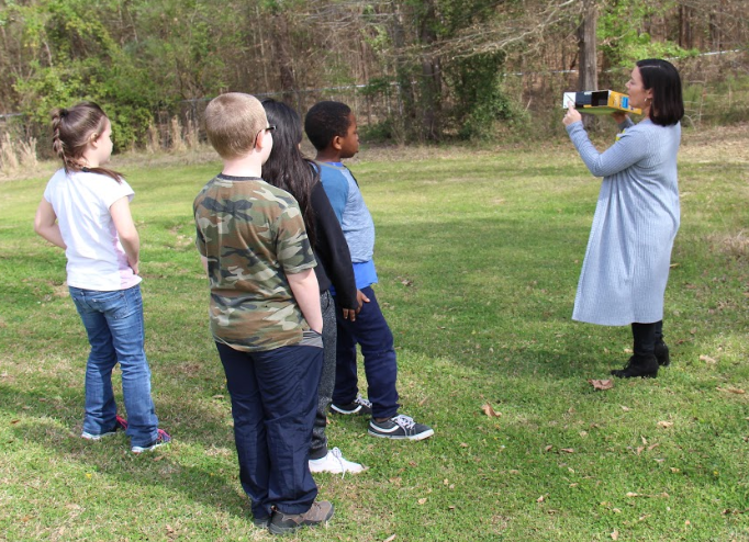 Local photographer Leslie Smith shows second grade students at B-L Primary School how to use a pinhole camera that was constructed out of a cardboard box. Leslie worked with students at BLPS for two weeks as part of an Artist in Residence program that came out of Lexington Three's recently expanded arts initiative.