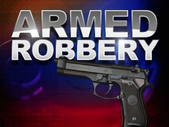 Lexington County Sheriff's Department investigators working on an armed robbery in Red Bank